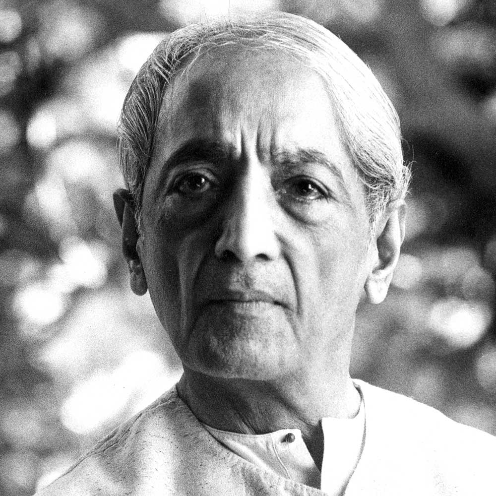 Black and white portrait of J. Krishnamurti