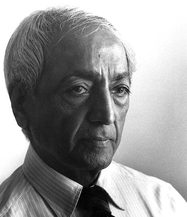 A black and white portrait photo of J. Krishnamurti