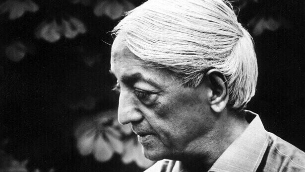 A black and white photograph of J. Krishnamurti